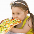Girl eating pizza — Stock Photo