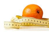 Centimetric tape and orange — Stock Photo