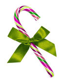 Purple candy cane with green bow, isolated on white — Stock Photo