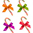 Set of candy cane with bow isolated on white — Stock Photo