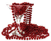 Red necklace in glass — Stock Photo