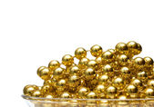 Background with gold beads — Stock Photo
