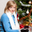 Young woman near a fir-tree — Stock Photo