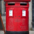 Red mail box in London - Stok fotoğraf