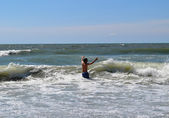 Teen playing in waves — Stock Photo