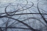 Tire track on asphalt — Stock Photo