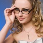 Постер, плакат: Красивая девушка в очках