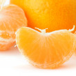 Segments and the whole tangerine - Stock Photo