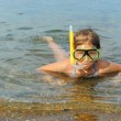The girl floats in sea — Stock Photo