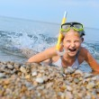 The girl on seacoast flounders about in water — Stock Photo #8347069