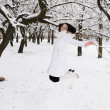 The girl jumps in winter forest. — Stock Photo