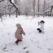 Stock Photo: Mum and daughter play snowballs