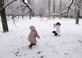 Mum and the daughter play snowballs — Stock Photo