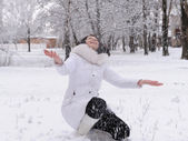 The woman in white and falling snow — Stock Photo
