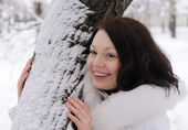 Portrait of the young woman in white at a tree — Stock Photo