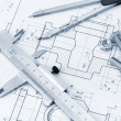 The plan industrial details, a screws, caliper, divider. A photo - Stock Photo