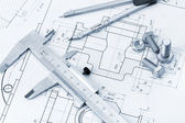 The plan industrial details, a screws, caliper, divider. A photo — Stock Photo