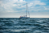Yacht in a stormy sea — Stock Photo