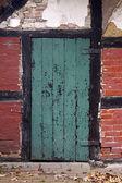 Dettaglio della porta di una vecchia casa colonica in germania — Foto Stock