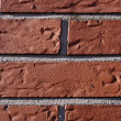 Stock Photo: House wall with red stones in Germany