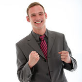 Excited businessman punching fists in jubilation — Stock Photo