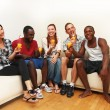 Stock Photo: Group of multi-ethnic friends enjoying a drink