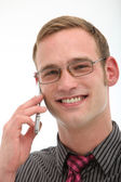Smiling friendly man on mobile phone — Stock Photo