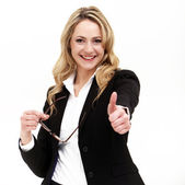 Attractive business woman giving thumbs up — Stock Photo