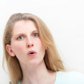 Young woman showing mild shock after hearing news — Stock Photo