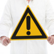 Stock Photo: Mholding caution sign with exclamation point