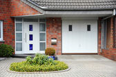 Modern entry door to the house — Stock Photo