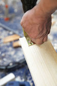 Craftsmen bolted to an angle of wood — Stock Photo