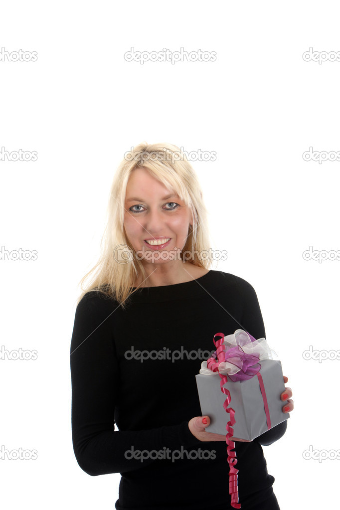 An attrative blond woman holding a small gift — Stock Photo #9348844