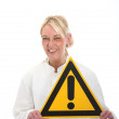 Smiling blonde holding a sign — Stock Photo