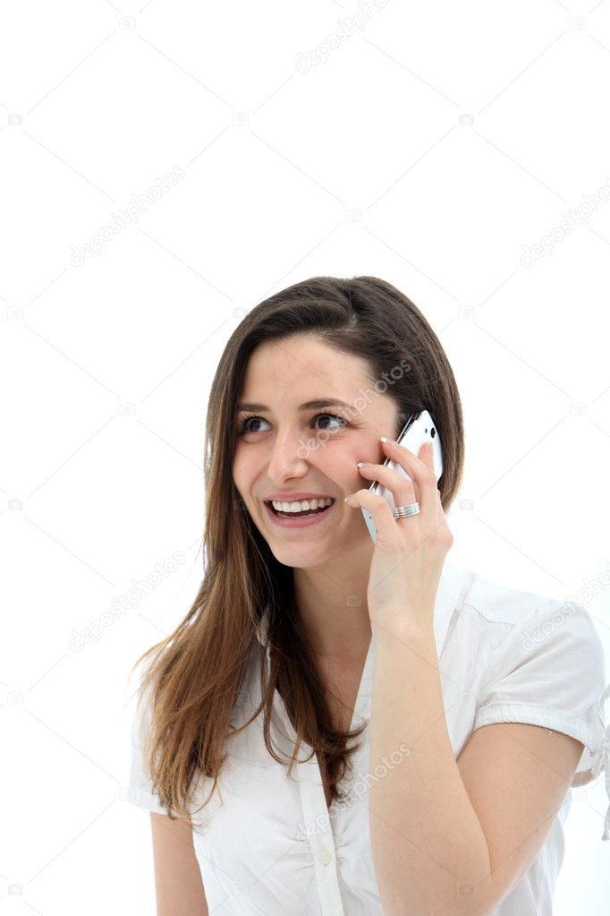 Smiling casual young woman in white blouse using her mobile phone — Stock Photo #9474434