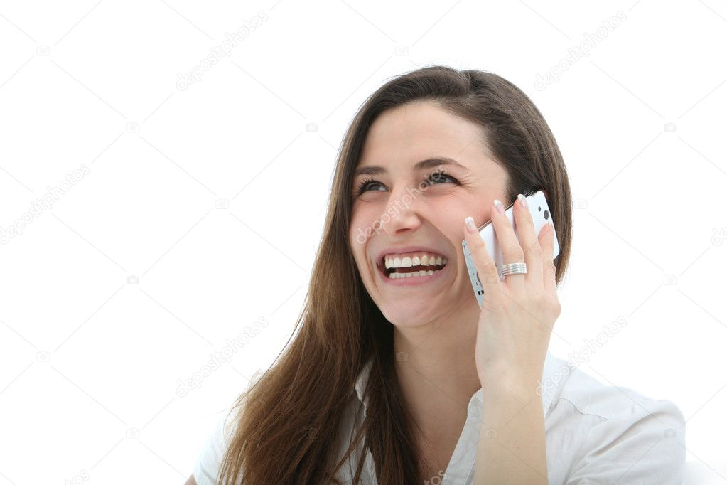 Attractive woman laughing merrily while speaking on her mobile phone — Lizenzfreies Foto #9474436