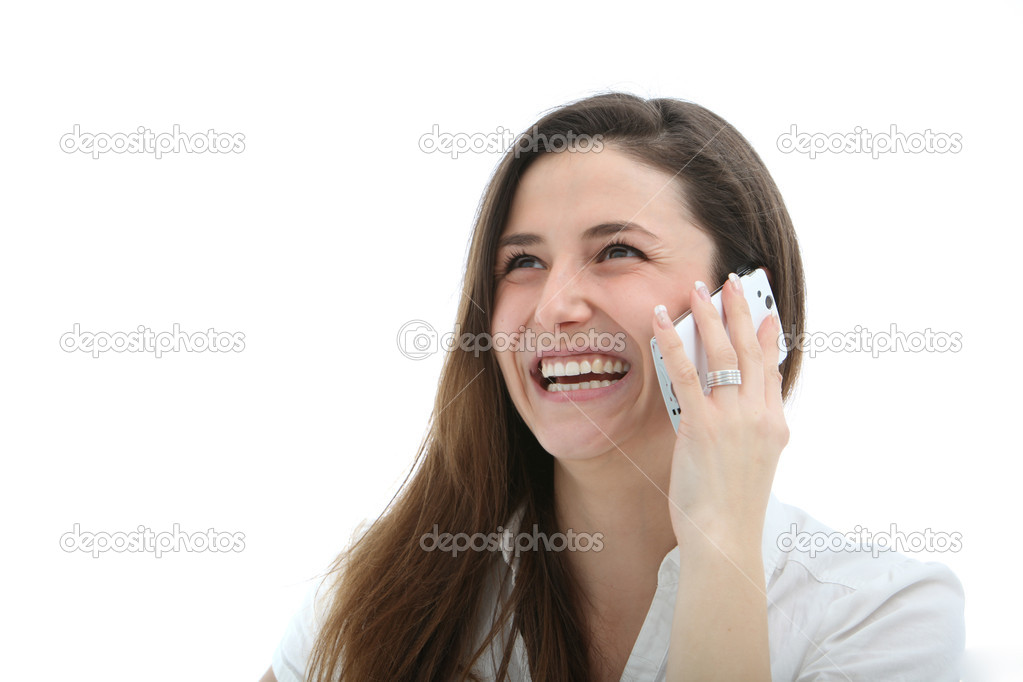 Attractive woman laughing merrily while speaking on her mobile phone — Stok fotoğraf #9474436