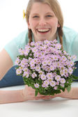 Smiling woman with flower bouquet — Stock Photo