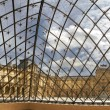 Louvre from iside of Pyramid. — Stock Photo