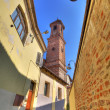 Old street and church tower in Alba. — Stock Photo