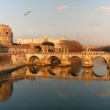 Stock Photo: Saint Angel castle and bridge over the Tiber river in Rome.