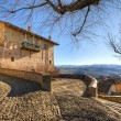 Stock Photo: Old house over village. SerralungD'Alba, Italy.
