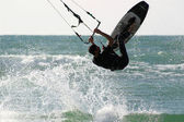 Kitesurfer jumps over the water. — Stock Photo