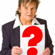 Female senior holding question mark — Stock Photo