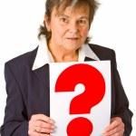 Female senior holding question mark — Stock Photo