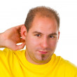 Young man hard of hearing — Stock Photo #10026261