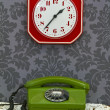 Retro telephone and Kitchen clock — Stock Photo