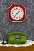 Retro telephone and Kitchen clock — Stock Photo