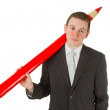 Freindly businessman with red pencil - Stock Photo
