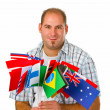 Young man with international flags - Stock Photo